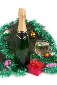 Champagne and christmas tree decorations — Stock Photo