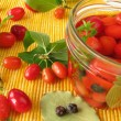 Cornelian cherries in vinegar marinade — Stock Photo