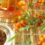 Rooibos tea with fruits of sea buckthorn — Stock Photo