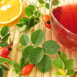 Fruit tea with rose hips and oranges - Stock Photo