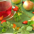 Fruit tea with rose hips and apples - Stock Photo