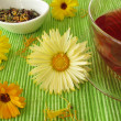 Fruit tea with flowers from marigolds - Stock Photo
