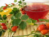 Fruit tea with rose hips and oranges — Stock Photo