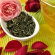 Green tea with rose flowers — Stock Photo