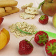 Stock Photo: Small children diet with fruits, cookies and oat flakes