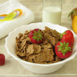 Breakfast for small children with spelt flakes and milk - Stock Photo