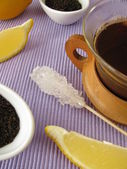 Black tea with lemon — Stock Photo