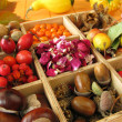 Collecting box with fall fruits and dried rose flowers — Stock Photo