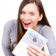 Young woman is happy to get a visa in her passport — Stock Photo