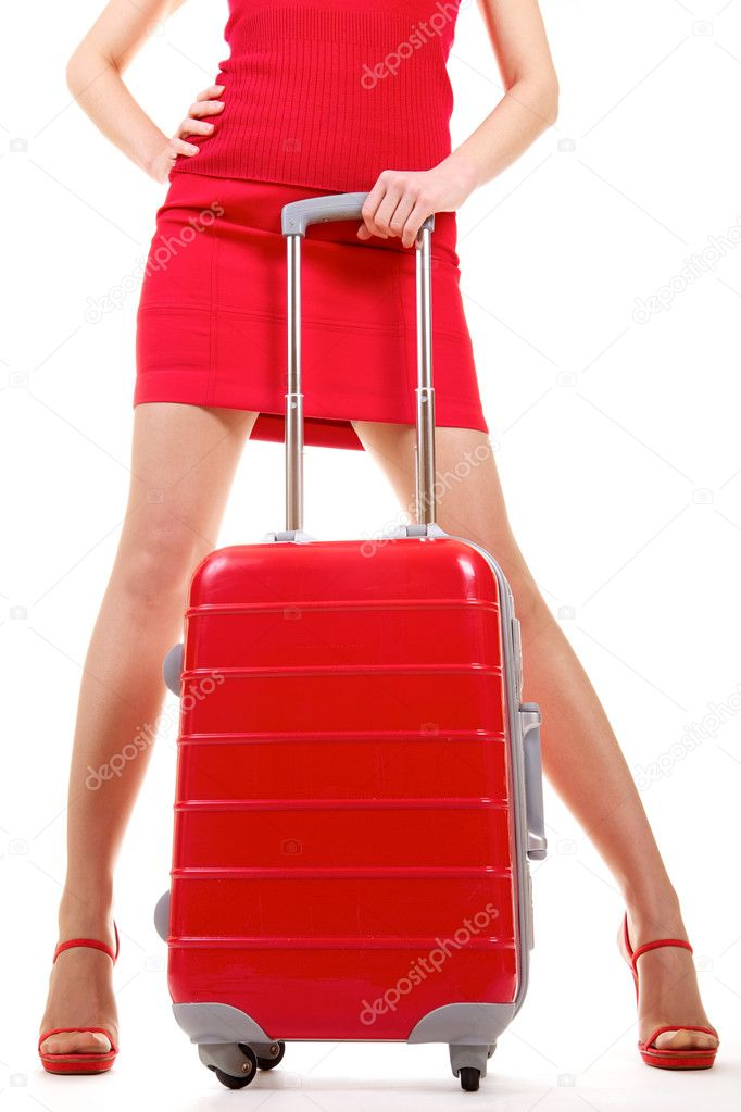 Young woman in red outfit standing with suitcase over white   Stock Photo #6746035