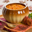 Stock Photo: Pumpkin soup in ceramic pot