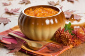 Pumpkin soup in ceramic pot — Stock Photo