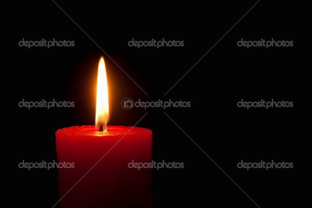 Closeup of a burning red candle in front of black background — Stock Photo #7282845
