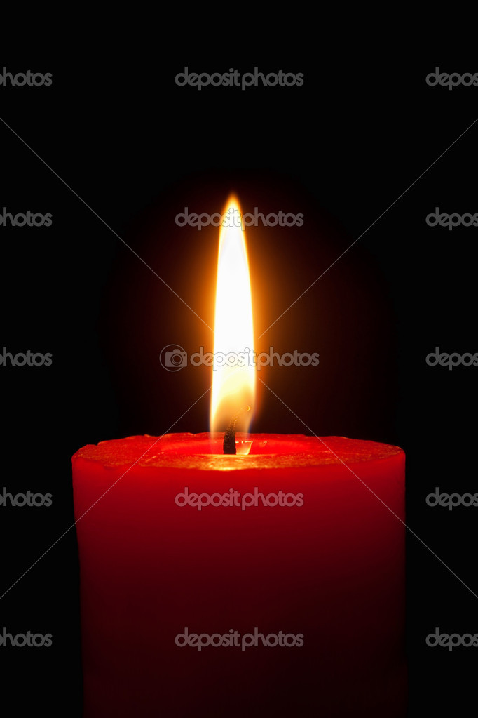 Closeup of a burning red candle in front of black background — Stock Photo #7282848
