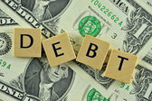 Debt in lettern — Stock Photo