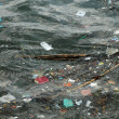 Waste on the surface of the ocean - Stock Photo