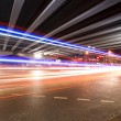Stock Photo: Light trails under the viaduct