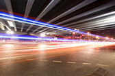Light trails under the viaduct — Stock Photo