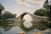 Stone arch bridge in summer palace — Stock Photo