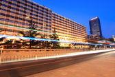 Modern beijing street traffic at dusk — Stock Photo