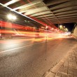 Light trails under the viaduct — Stock Photo #7553090