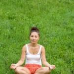 Girl meditating in park — Stock Photo #6841133