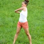 Girl doing exercises in park — Stock Photo #6841373