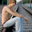 Handsome man walking near rails — Stock Photo