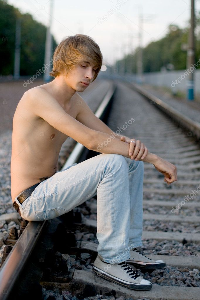 Handsome man walking near rails — Stock Photo #6887056
