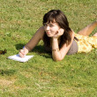 Girl lying on grass in park — Stock Photo #6902180