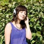 Girl listening music in headphones — Stock Photo #6902344