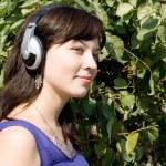 Girl listening music in headphones — Stock Photo #6902346