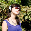 Girl listening music in headphones — 图库照片