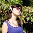 Girl listening music in headphones — 图库照片 #6902380