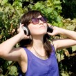 Girl listening music in headphones — Stock Photo #6902429