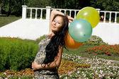 Joyful pregnant girl with colorful balloons — Stock Photo