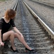 Girl walking near rails - Foto Stock