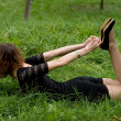 Sexy girl lying on grass — Stock Photo #6995854