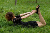 Sexy girl lying on grass — Stock Photo