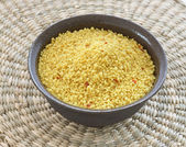 Brown bowl with couscous on white background — Stock Photo
