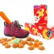 Purple little children's shoe with presents and pepernoten — Stock Photo