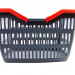 Empty grey shopping basket with red handles — Stock Photo