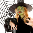 Stock Photo: Scary little green witches for Halloween with spiderweb