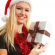 Portrait of blonde woman with christmas hat and present — Stok fotoğraf
