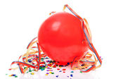 Red party balloon, confetti and streamers — Stock Photo