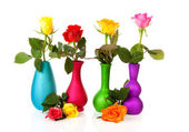 Colorful roses in vases — Stock Photo