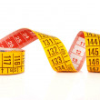 Yellow measure tape — Stock Photo #7459904