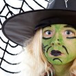 Scary green witch for Halloween with spiderweb — Stock Photo