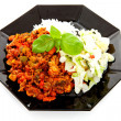 Plate with delicious chilli con carne - Stock Photo