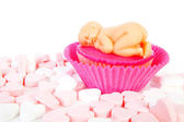 Birth cupcake with marzipan baby — Stock Photo
